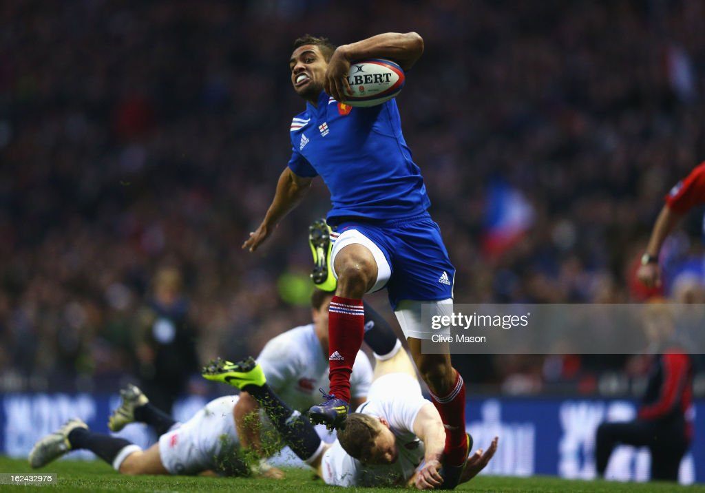 Wesley Fofana of France breaks away from Chris Ashton and Ben Youngs of England to score a try during the RBS Six Nations match between England and France at Twickenham Stadium on February 23, 2013 in London, England.
