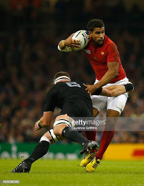 Wesley Fofana of France is tackled by Kieran Read of the New Zealand All Blacks during the 2015 Rugby World Cup Quarter Final match between New...