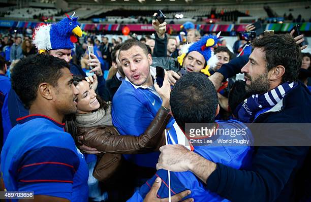 Wesley Fofana of France poses with fans during the 2015 Rugby World Cup Pool D match between France and Romania at the Olympic Stadium on September...