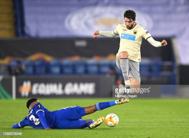 Wesley Fofana of Leicester City tackles Karim Ansarifard of AEK during the UEFA Europa League Group G stage match between Leicester City and AEK...