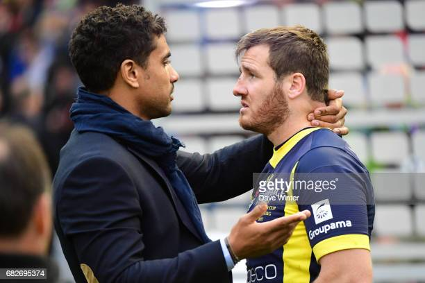 Wesley Fofana tries to console Camille Lopez of Clermont after the European Champions Cup Final match between Clermont Auvergne and Saracens at...