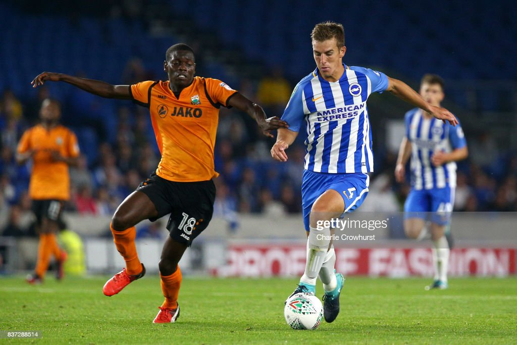 Wesley Fonguck of Barnet and Uwe Hunemeier of Brighton and Hove Albion battle for possession during the Carabao Cup Second Round match between Brighton & Hove Albion and Barnet at Amex Stadium on August 22, 2017 in Brighton, England.