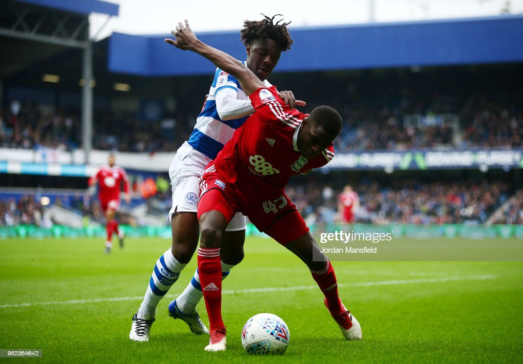Wesley Harding of Birmingham tackles with Ebere Eze of QPR during the Sky Bet Championship match between Queens Park Rangers and Birmingham City at Loftus Road on April 28, 2018 in London, England.