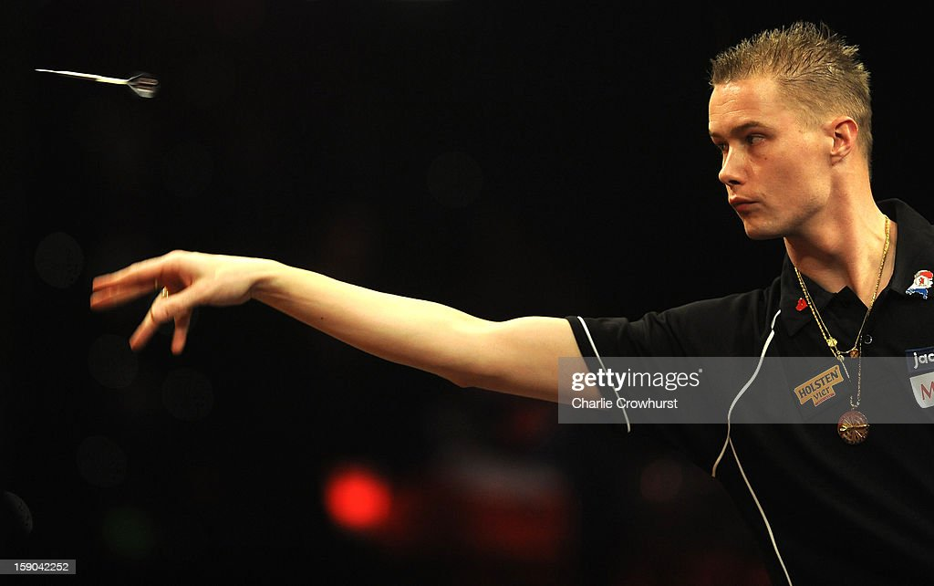 Wesley Harms of The Netherlands in action during his first round match against Rune David of Norway on day two of the BDO Lakeside World Professional Darts Championships at Lakeside Country Club on January 06, 2013 in London, England.