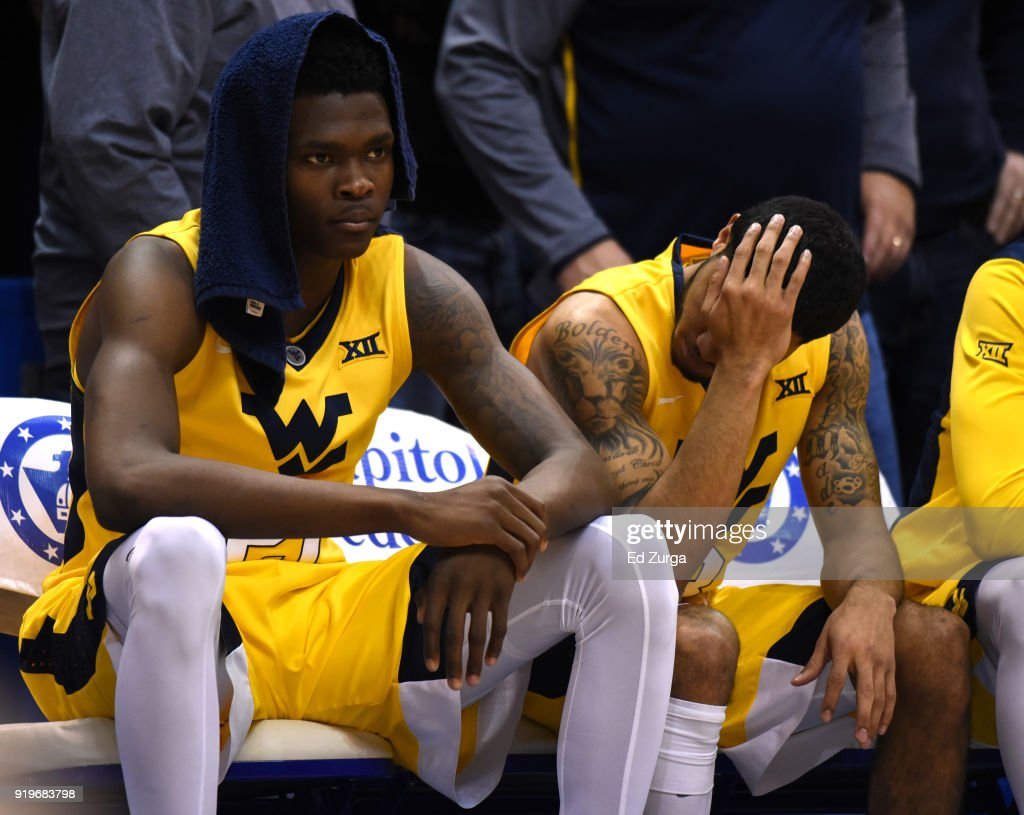Wesley Harris #21 and James Bolden #3 of the West Virginia Mountaineers sit dejected on the bench during the closing minute of a game against the Kansas Jayhawks at Allen Fieldhouse on February 17, 2018 in Lawrence, Kansas. Kansas won 77-69.