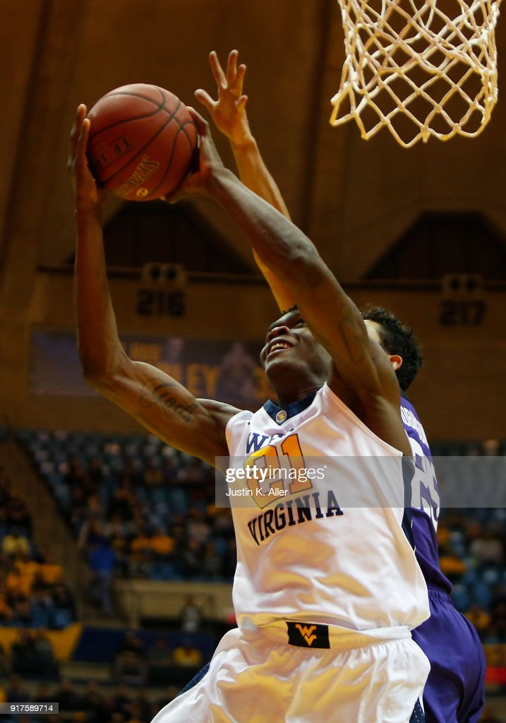 Wesley Harris #21 of the West Virginia Mountaineers attempts a shot against the TCU Horned Frogs at the WVU Coliseum on February 12, 2018 in Morgantown, West Virginia.