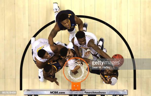 Wesley Harris of the West Virginia Mountaineers defends a shot by Terrell Miller Jr #0 of the Murray State Racers during the first round of the 2018...