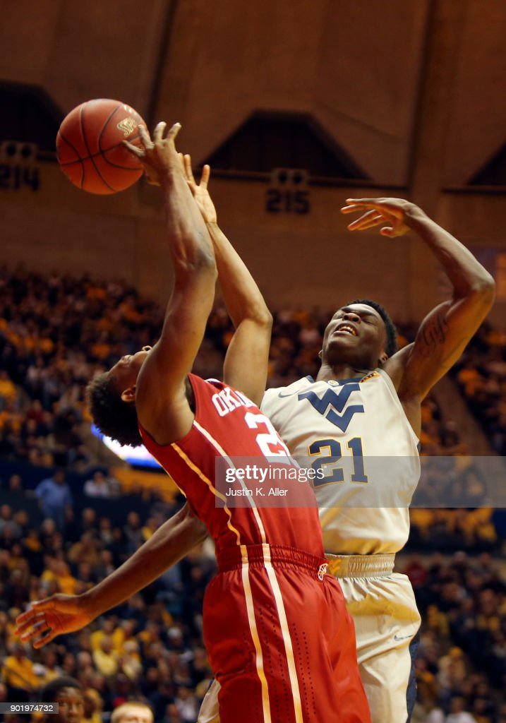 Wesley Harris #21 of the West Virginia Mountaineers fouls Kameron McGusty #20 of the Oklahoma Sooners at the WVU Coliseum on January 6, 2018 in Morgantown, West Virginia.