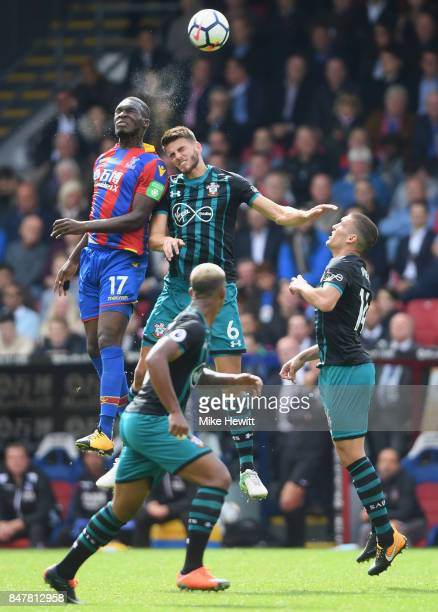 Wesley Hoedt of Southampton and Christian Benteke of Crystal Palace battle for possession during the Premier League match between Crystal Palace and...