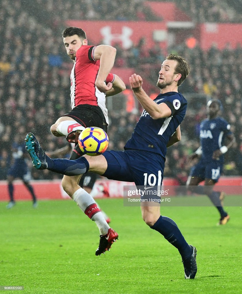 Wesley Hoedt of Southampton and Harry Kane of Tottenham Hotspur battle for the ball during the Premier League match between Southampton and Tottenham Hotspur at St Mary's Stadium on January 21, 2018 in Southampton, England.