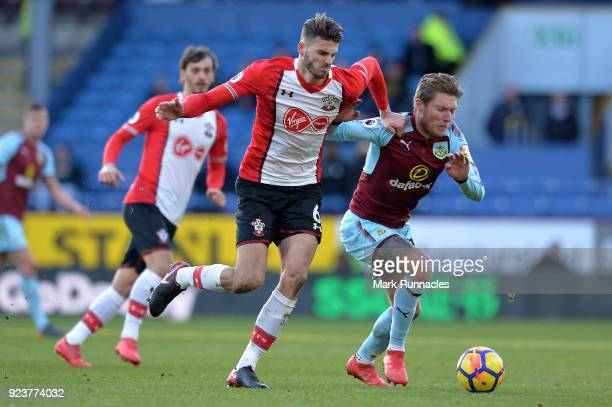 Wesley Hoedt of Southampton and Jeff Hendrick of Burnley battle for the ball during the Premier League match between Burnley and Southampton at Turf...