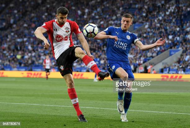 Wesley Hoedt of Southampton cleras the ball while under pressure from Jamie Vardy of Leicester City during the Premier League match between Leicester...