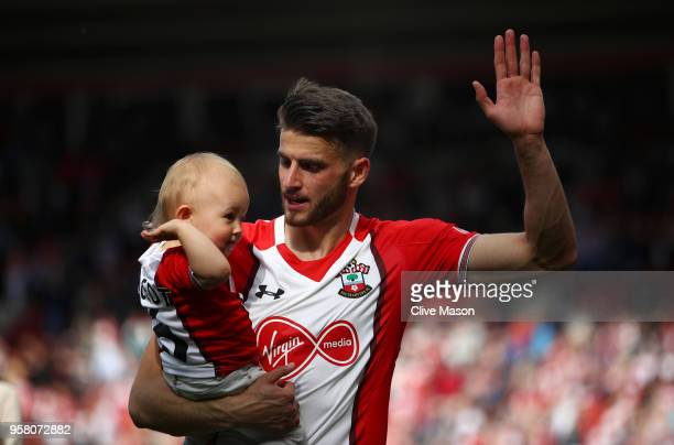 Wesley Hoedt of Southampton enjoys the lap of honour with his child after the Premier League match between Southampton and Manchester City at St...