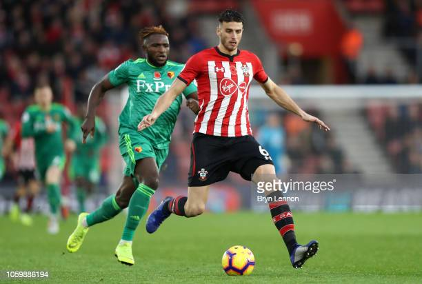 Wesley Hoedt of Southampton is challenged by Isaac Success of Watford during the Premier League match between Southampton FC and Watford FC at St...