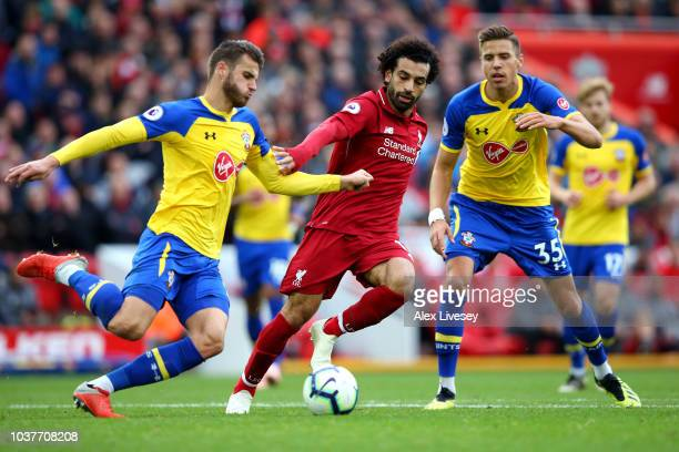 Wesley Hoedt of Southampton is challenged by Mohamed Salah of Liverpool during the Premier League match between Liverpool FC and Southampton FC at...