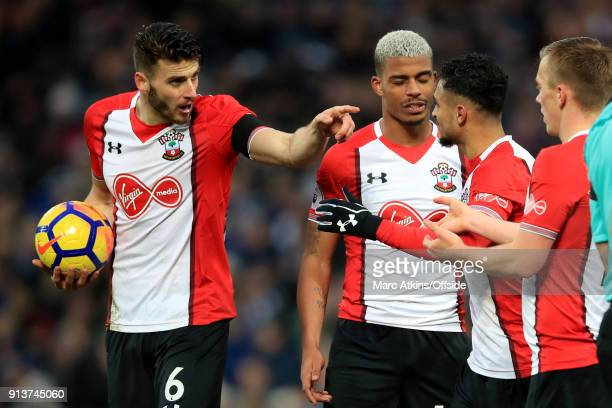 Wesley Hoedt of Southampton points at team mate Sofiane Boufal as he argues with James WardProwse over who should take a free kick during the Premier...