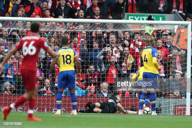 Wesley Hoedt of Southampton scores an own goal during the Premier League match between Liverpool FC and Southampton FC at Anfield on September 22...