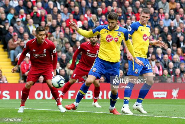 Wesley Hoedt of Southampton scores an own goal for Liverpool's first goal during the Premier League match between Liverpool FC and Southampton FC at...