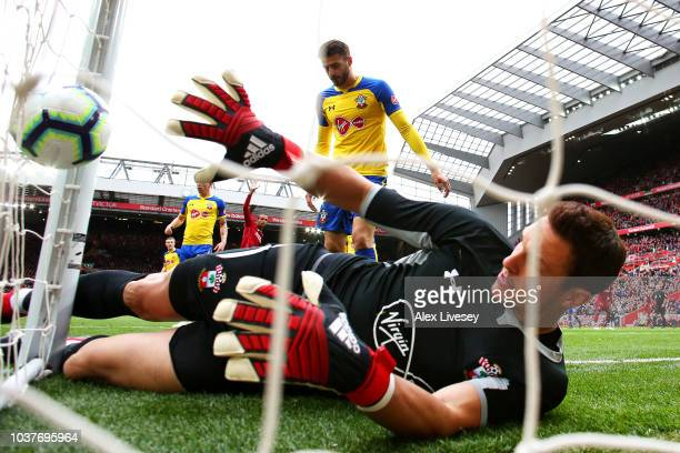 Wesley Hoedt of Southampton scores an own goal past Alex McCarthy of Southampton for Liverpool's first goal during the Premier League match between...