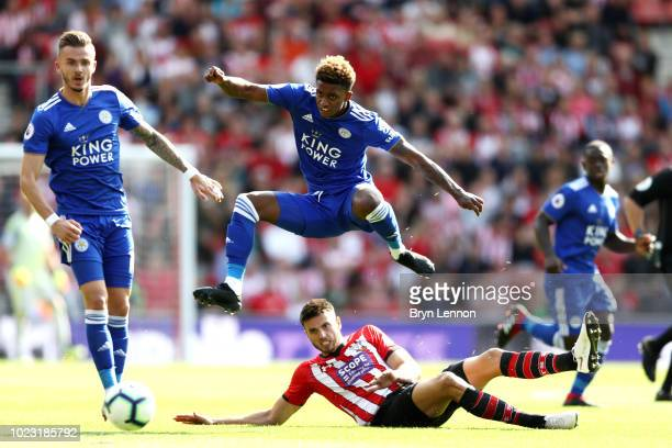 Wesley Hoedt of Southampton tackles Demarai Gray of Leicester City during the Premier League match between Southampton FC and Leicester City at St...