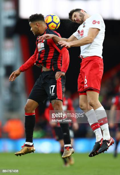 Wesley Hoedt of Southampton wins a header over Joshua King of AFC Bournemouth during the Premier League match between AFC Bournemouth and Southampton...