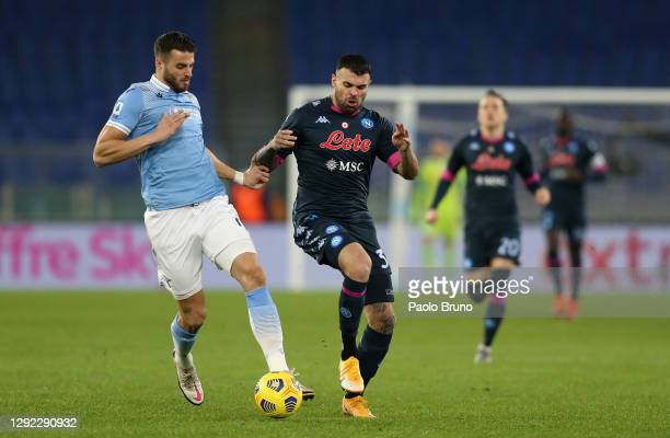 Wesley Hoedt of SS Lazio is challenged by Andrea Petagna of SSC Napoli during the Serie A match between SS Lazio and SSC Napoli at Stadio Olimpico on...