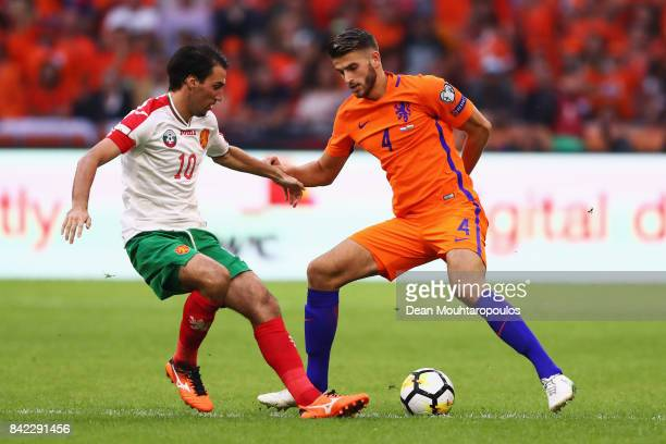 Wesley Hoedt of the Netherlands battles for the ball with Ivelin Popov of Bulgaria during the FIFA 2018 World Cup Qualifier between the Netherlands...