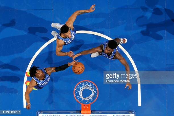 Wesley Iwundu and Jonathan Isaac of the Orlando Magic go for a rebound against the Charlotte Hornets on February 14 2019 at Amway Center in Orlando...