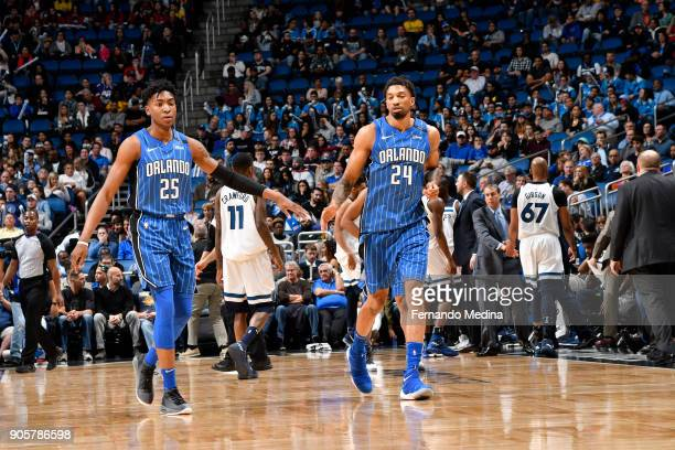 Wesley Iwundu and Khem Birch of the Orlando Magic react during game against the Minnesota Timberwolves on January 16 2018 at Amway Center in Orlando...