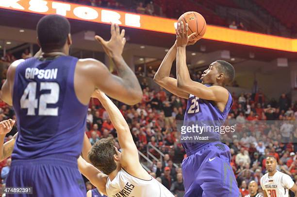 Wesley Iwundu of the Kansas State Wildcats draws a blocking foul against Dusty Hannahs of the Texas Tech Red Raiders during game action between the...