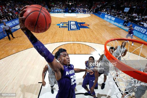 Wesley Iwundu of the Kansas State Wildcats dunks the ball in the first half against the Wake Forest Demon Deacons during the First Four game in the...