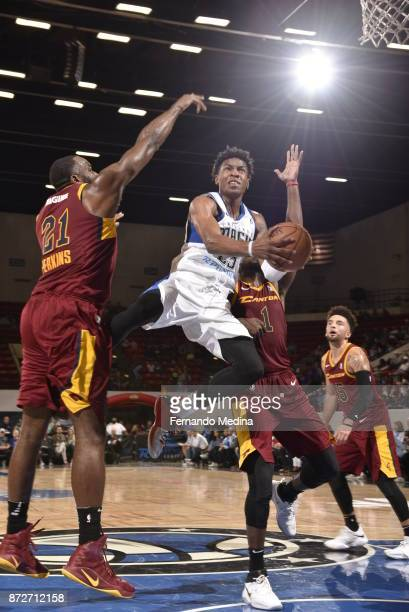 Wesley Iwundu of the Lakeland Magic drives to the hoop against Kendrick Perkins and John Holland of the Canton Charge during the game on November 10...