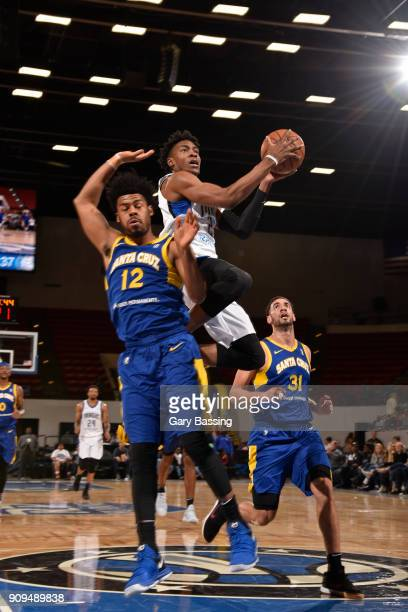 Wesley Iwundu of the Lakeland Magic goes for a lay up against Quinn Cook of the Santa Cruz Warriors on January 5 2018 at RP Funding Center in...
