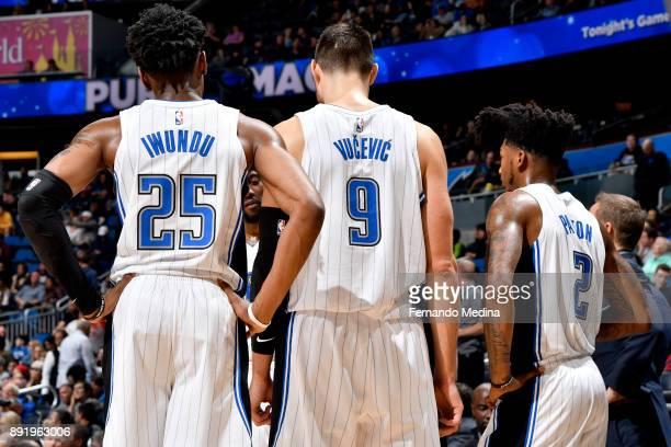 Wesley Iwundu of the Orlando Magic Nikola Vucevic of the Orlando Magic and Elfrid Payton of the Orlando Magic huddle during the game against the LA...