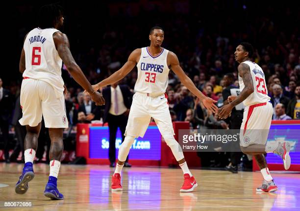 Wesley Johnson of the LA Clippers celebrates a Lou Williams three pointer with DeAndre Jordan during the second quarter in a 120115 win over the Los...