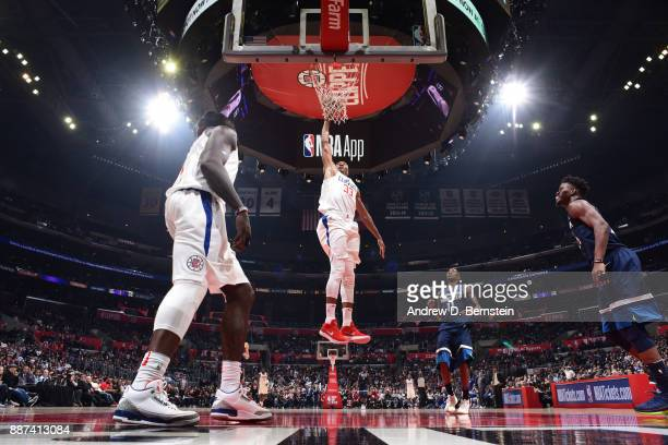 Wesley Johnson of the LA Clippers dunks against the Minnesota Timberwolves on December 6 2017 at STAPLES Center in Los Angeles California NOTE TO...