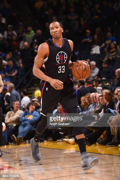 Wesley Johnson of the LA Clippers handles the ball against the Golden State Warriors on February 23 2017 at ORACLE Arena in Oakland California NOTE...