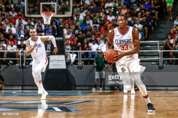 Wesley Johnson of the LA Clippers handles the ball during the preseason game against the Toronto Raptors on October 4 2017 at the Stan Sheriff Center...