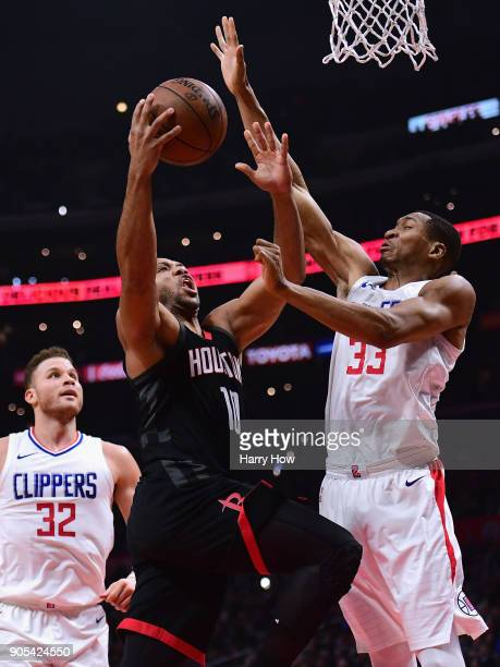 Wesley Johnson of the LA Clippers prepares to block the shot of Eric Gordon of the Houston Rockets during the first half at Staples Center on January...