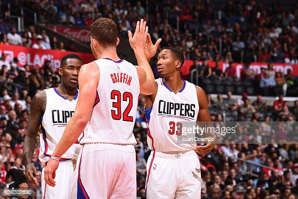 Wesley Johnson of the LA Clippers reacts with teammates Blake Griffin and Jamal Crawford during the game against the Portland Trail Blazers on...