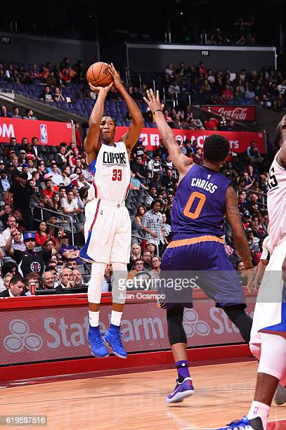 Wesley Johnson of the LA Clippers shoots the ball over Marquese Chriss of the Phoenix Suns during a game on October 31 2016 at the STAPLES Center in...
