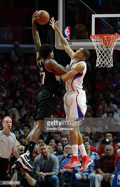 Wesley Johnson of the Los Angeles Clippers blocks a layup by Ed Davis of the Portland Trail Blazers during the second half in Game One of the Western...