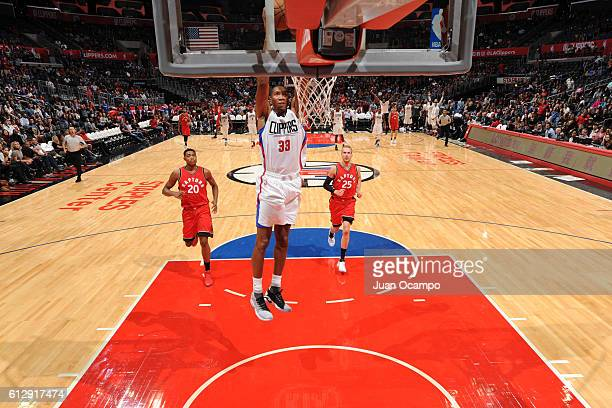 Wesley Johnson of the Los Angeles Clippers dunks against the Toronto Raptors on October 5 2016 at STAPLES Center in Los Angeles California NOTE TO...