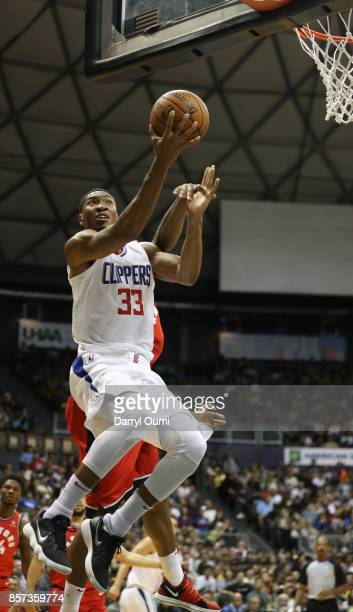Wesley Johnson of the Los Angeles Clippers glides to the basket during the third quarter of the game against the Toronto Raptors at the Stan Sheriff...