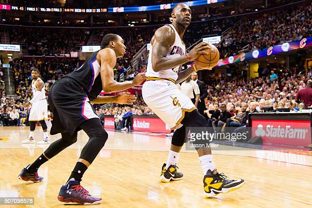 Wesley Johnson of the Los Angeles Clippers puts pressure on LeBron James of the Cleveland Cavaliers during the second half at Quicken Loans Arena on...