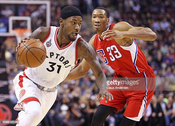 Wesley Johnson of the Los Angeles Clippers tries to cover Terrence Ross of the Toronto Raptors during an NBA game at the Air Canada Centre on January...
