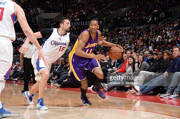 Wesley Johnson of the Los Angeles Lakers drives to the basket against Hedo Turkoglu of the Los Angeles Clippers on April 7 2015 at Staples Center in...