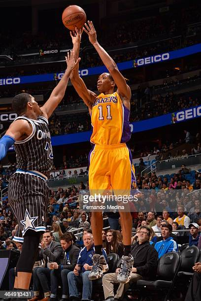 Wesley Johnson of the Los Angeles Lakers shoots against the Orlando Magic on January 24 2014 at Amway Center in Orlando Florida NOTE TO USER User...