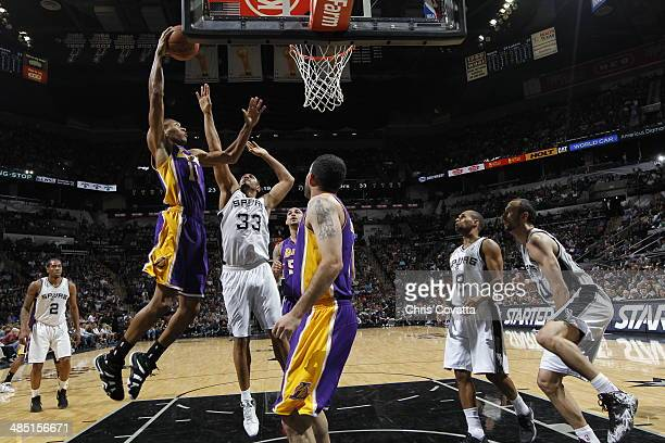 Wesley Johnson of the Los Angeles Lakers shoots against the San Antonio Spurs on April 16 2014 at the ATT Center in San Antonio Texas NOTE TO USER...