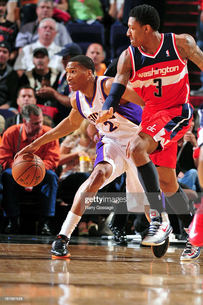 Wesley Johnson #2 of the Phoenix Suns dribbles the ball against Bradley Beal #3 of the Washington Wizards on March 20, 2013 at U.S. Airways Center in Phoenix, Arizona.